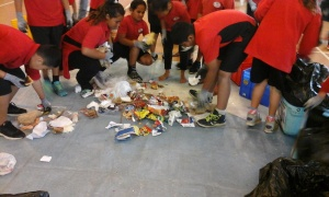 Ofa and the other Enviro Warriors sorting a bag of rubbish